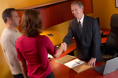 Couple meeting with businessman